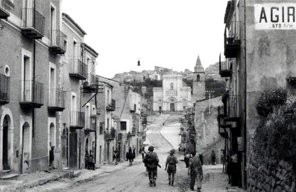 A historical image of a town in Italy.