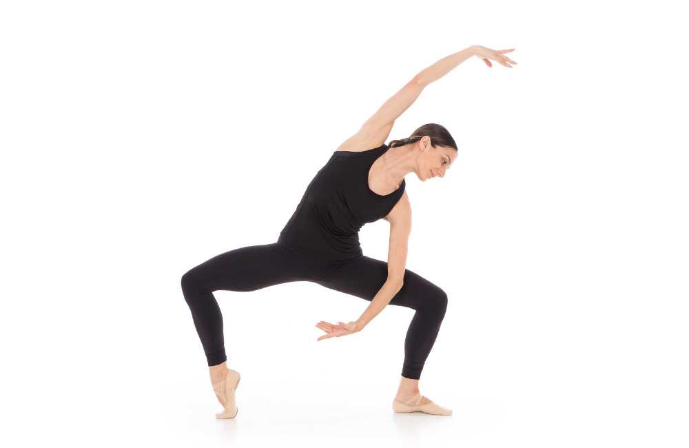 An adult dancer participating in an Adult Barre Fitness class.