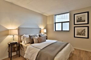 A bedroom with furnishings in a Villa Charities apartment for independent seniors.