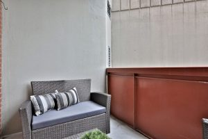 An outdoor balcony in a Villa Charities apartment for independent seniors.
