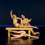 Three dancers performing at a DanzArts Toronto showcase.