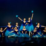 A group of dancers performing at a DanzArts Toronto showcase.