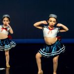 Two young dancers performing at a DanzArts Toronto showcase.