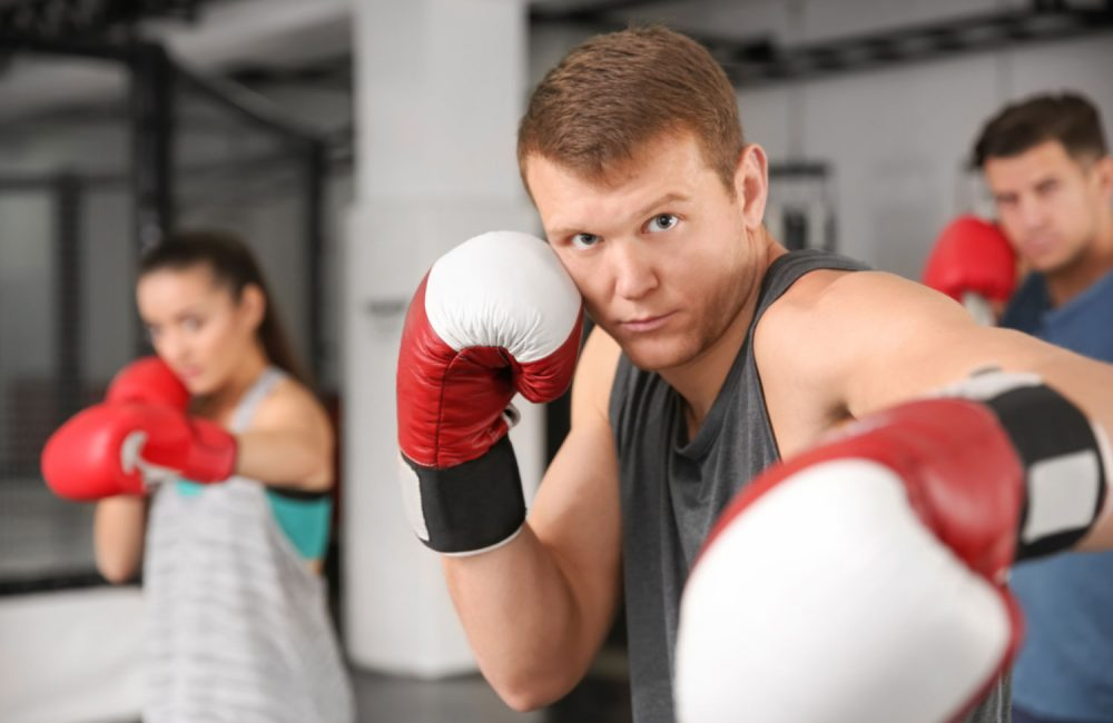 A group of people training at a boxing class.