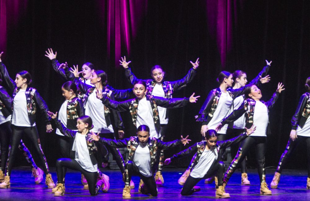 A group of competitive DanzArts Toronto dancers pose during a dance performance.