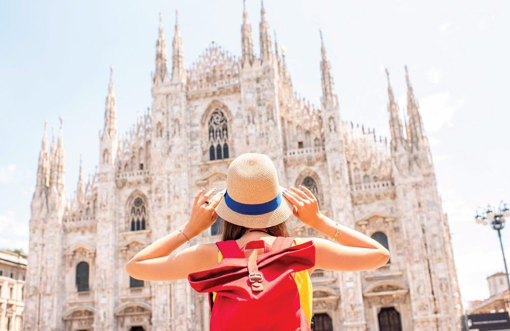 A female facing the Milan Cathedral.