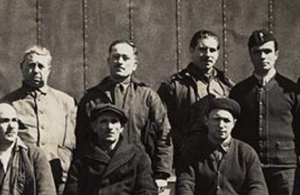 A historical image of a group posing for a photo together.